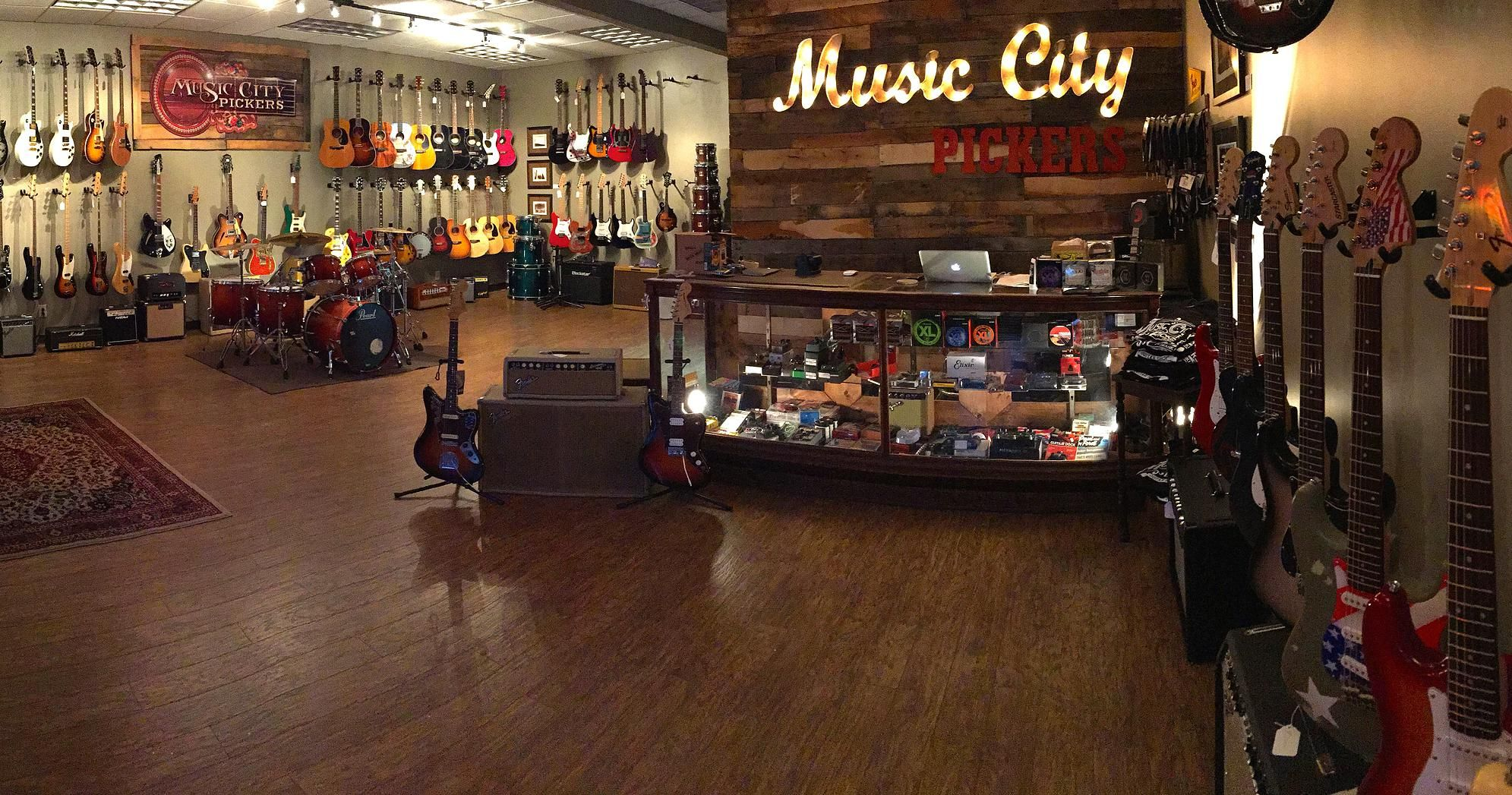 Music City Pickers Vintage Guitars Used Musical Instruments Guitar Store Music Store Interior Music Store Design