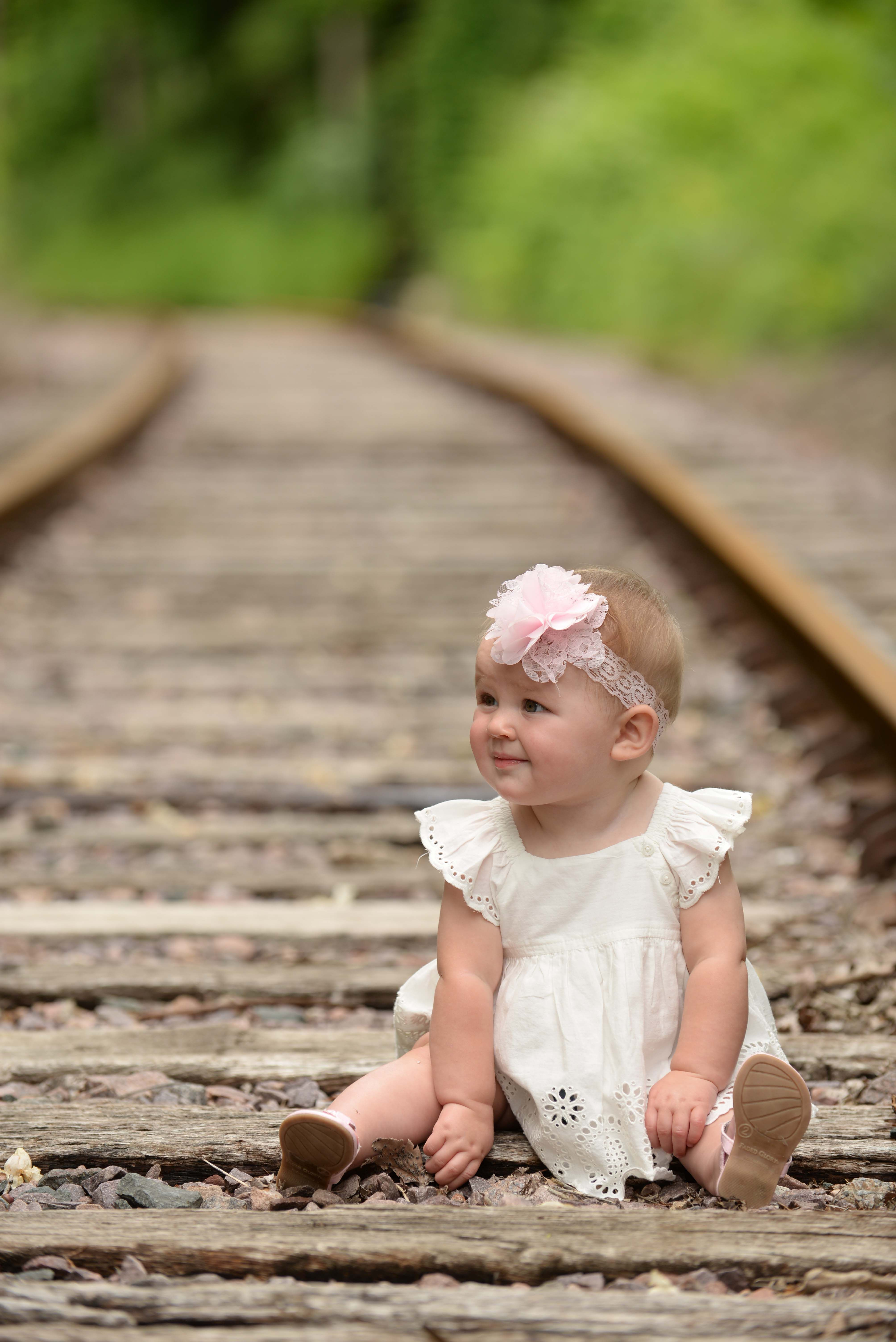 Outdoor Baby photo baby girl on railroad tracks candid child