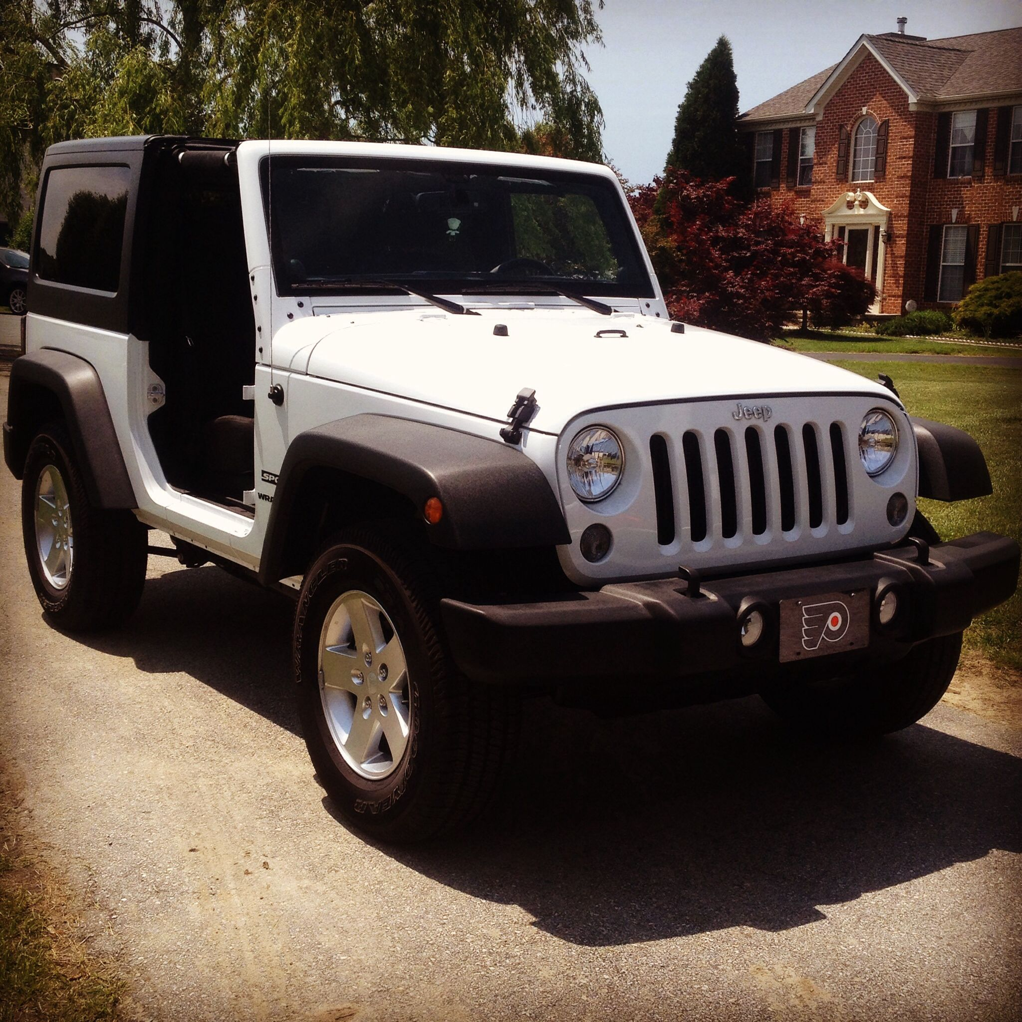 My dream car 2014 Jeep Wrangler Sport T top and doors off