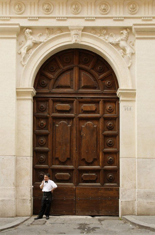 The Little Man And The Giant Door Rome Architecture