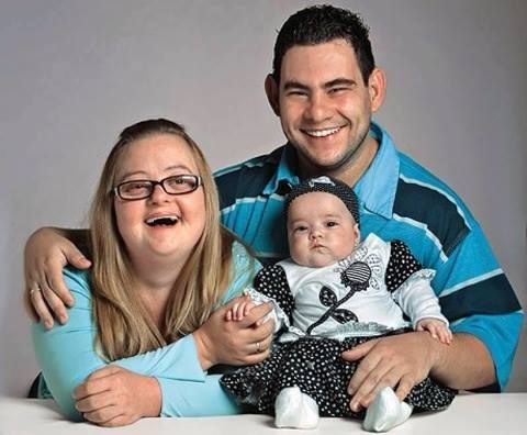 Mother with Downs Syndrome, Father with slight mental handicap, completely normal baby, one incredibly happy family.