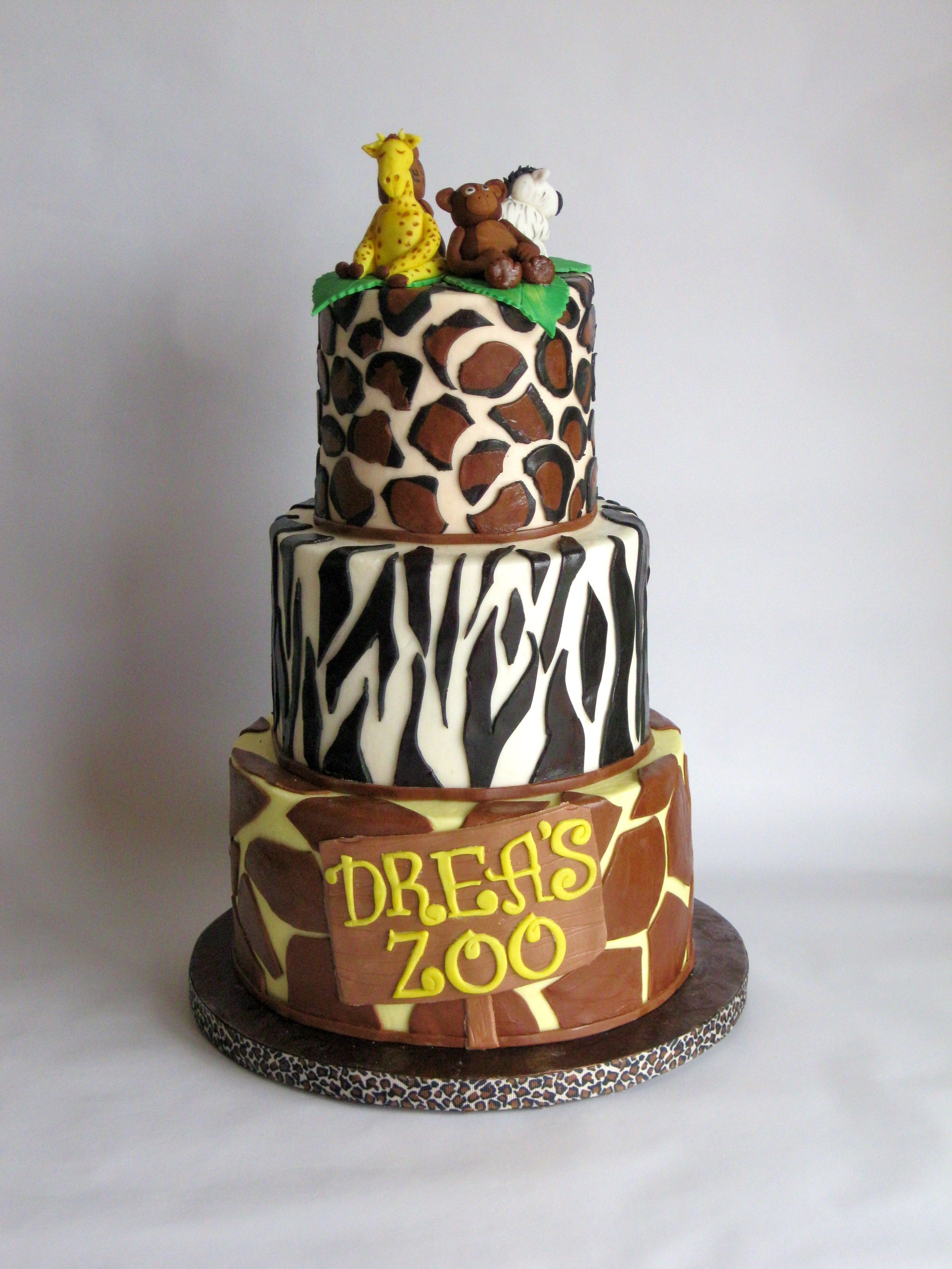 Animal zoo themed birthday cake covered in buttercream with