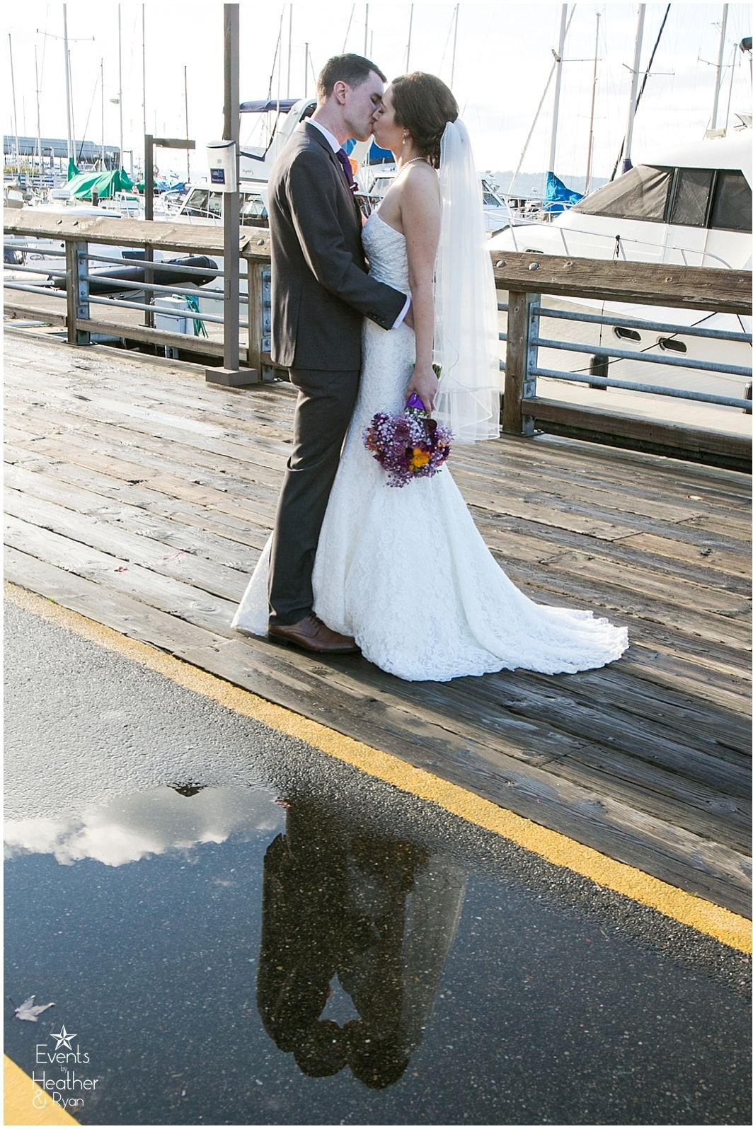 The sun came out after the rain an we were so lucky to find the perfect puddle for this photo!   #eventsbyhr #reflectionphoto #brideandgroom #sunandrain #edmondsyachthclub #edmondswedding  #rainyday #kissingaftertherain #waterfrontwedding #pnwwedding #edmondsyachtclubwedding