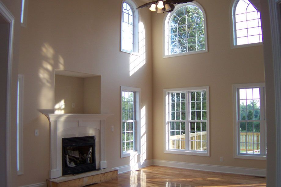 recessed tv nook above fire place and flanking windows