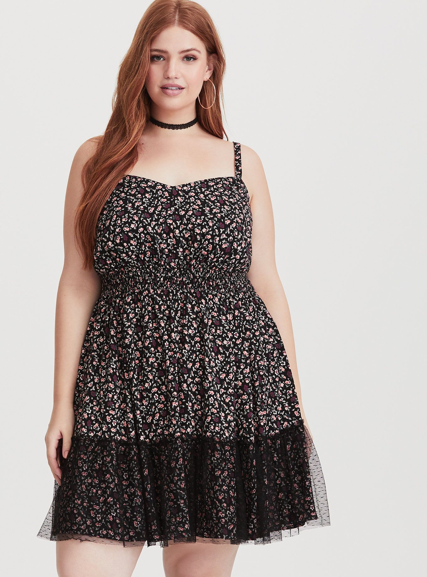 87e61fdf486 This little black cami dress features a peachy floral print for a bloom of  color