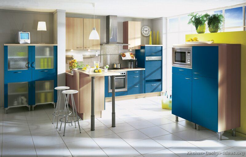 Kitchen of the day a modern blue kitchen with natural for Blue kitchen cabinets with yellow walls