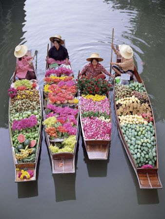 Thai floating market, flower vendors. I love the boats filled with flowers! So beautiful.
