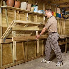 Fold out work bench home stuff garage pinterest bench why not cheat and use an old solid door do it yourself maximize space in the garage for storage or work space solutioingenieria Gallery