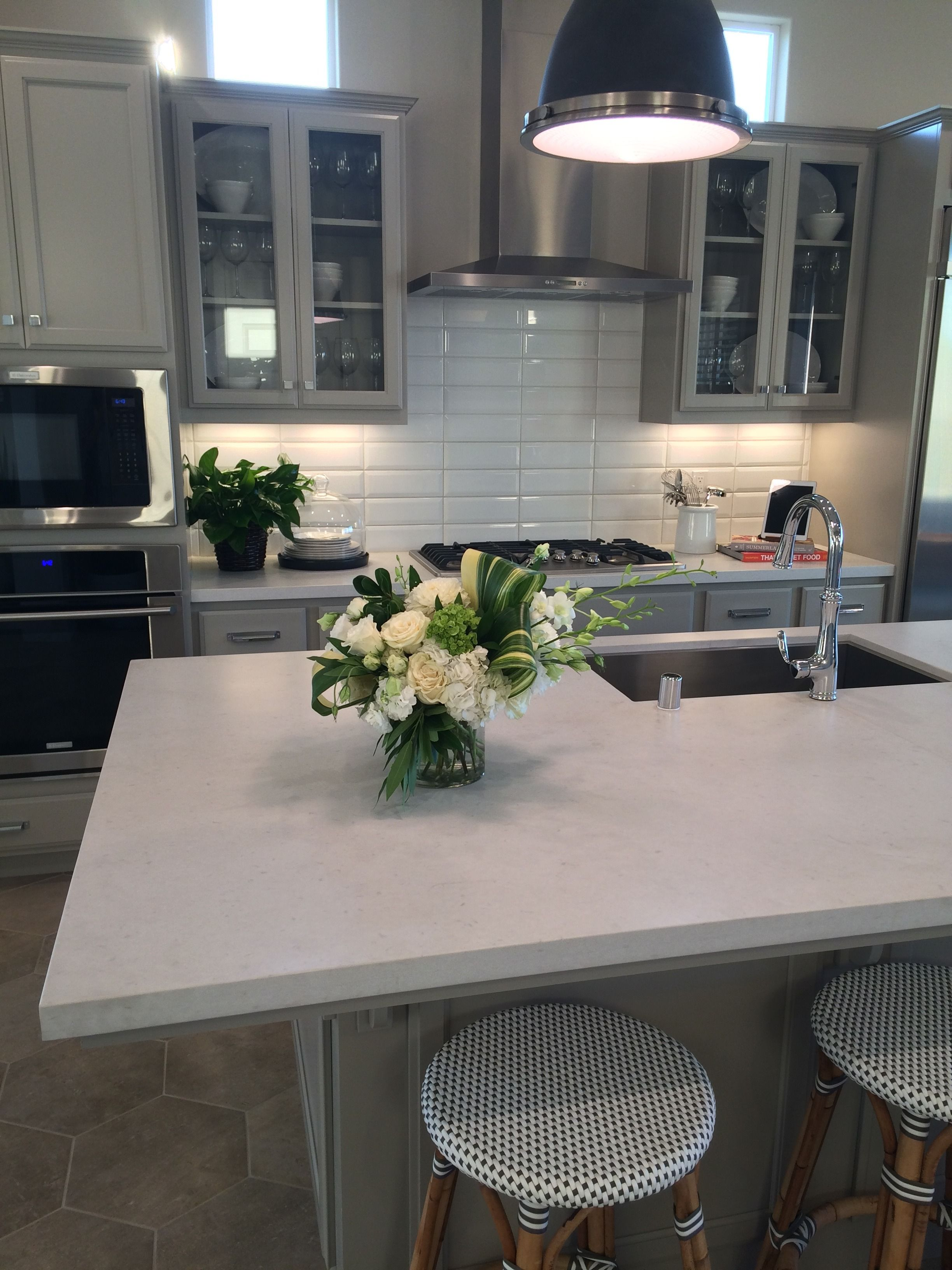 White cabinets. Caesarstone concrete counter tops. Large subway tile ...