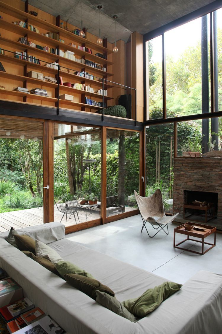 Gorgeous living room with generous windows nad a mezzanine library ...