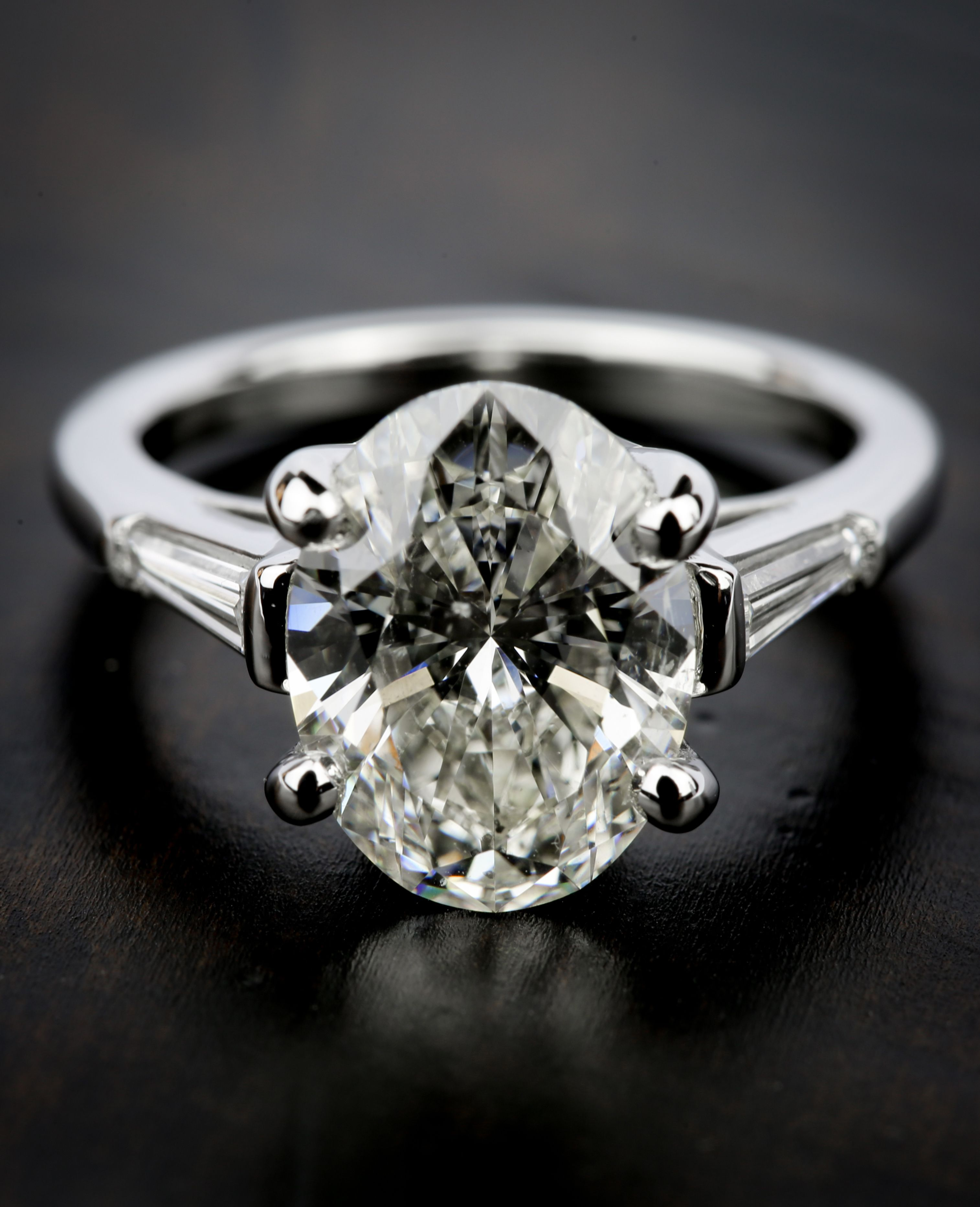 This stunning Three Stone Oval and Tapered Baguette