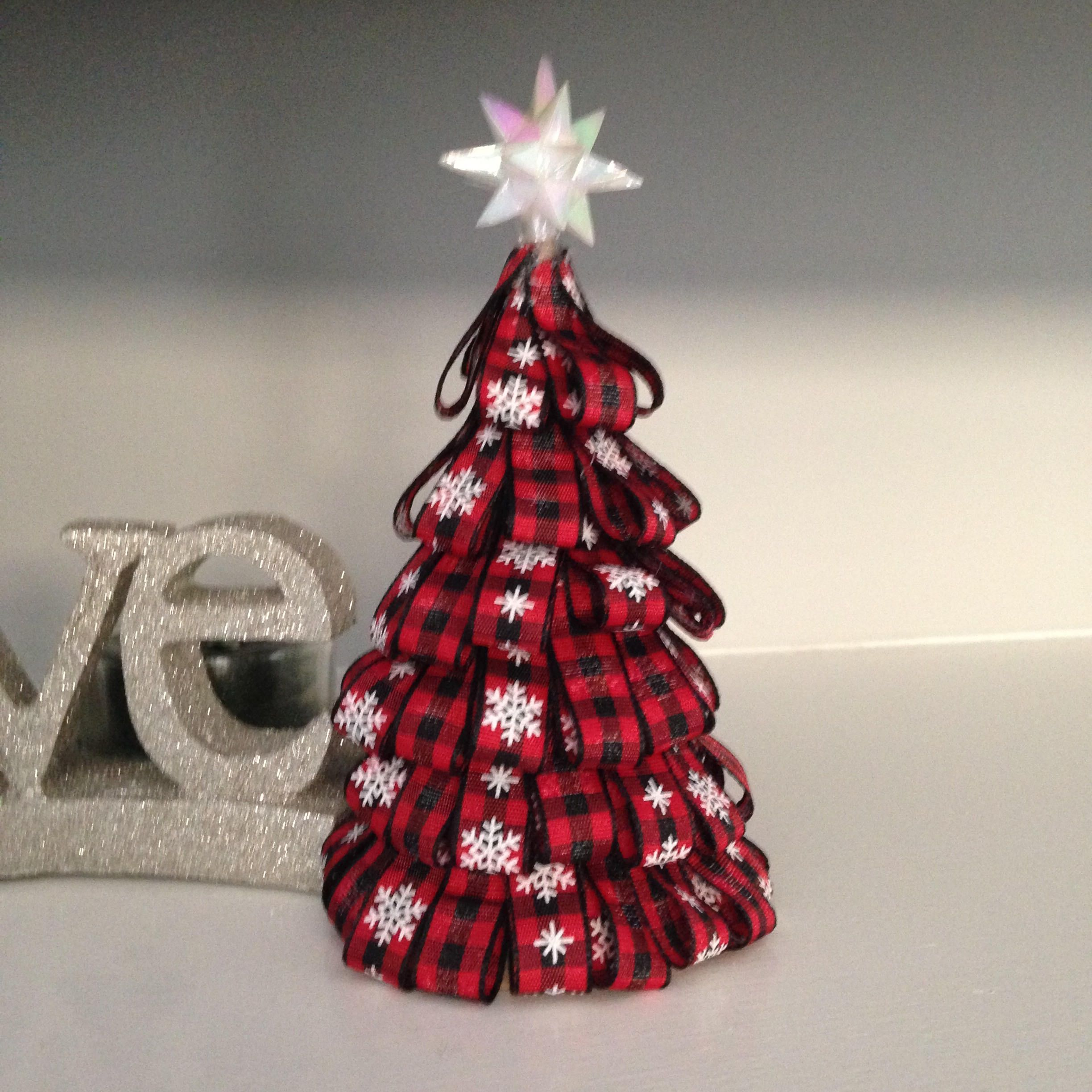 Ribbon tree with your choice of all buffalo plaid, alternating buffalo plaid and snow flake print on plaid or all snow flake buffalo ribbon