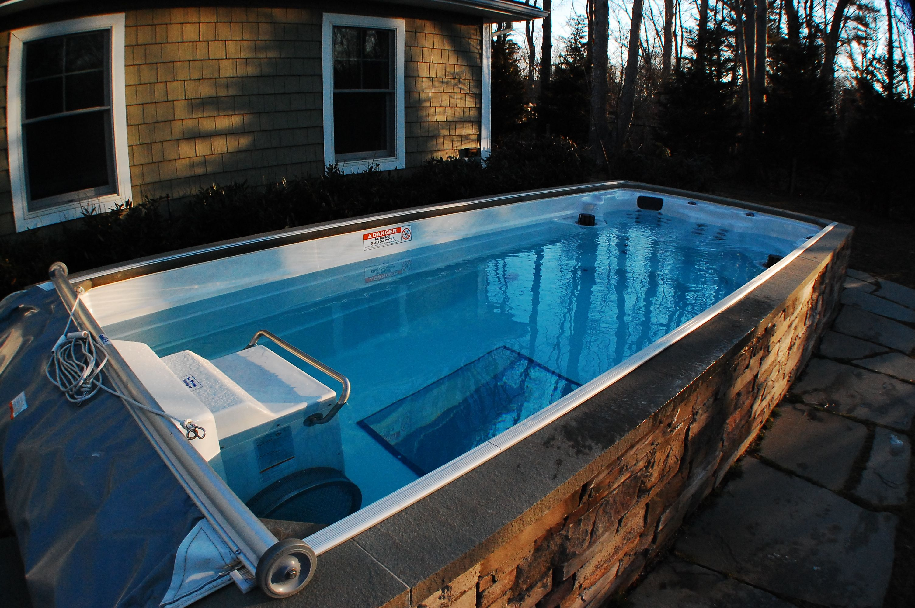 The 17' Endless Pool Swim Spa in this backyard is a great
