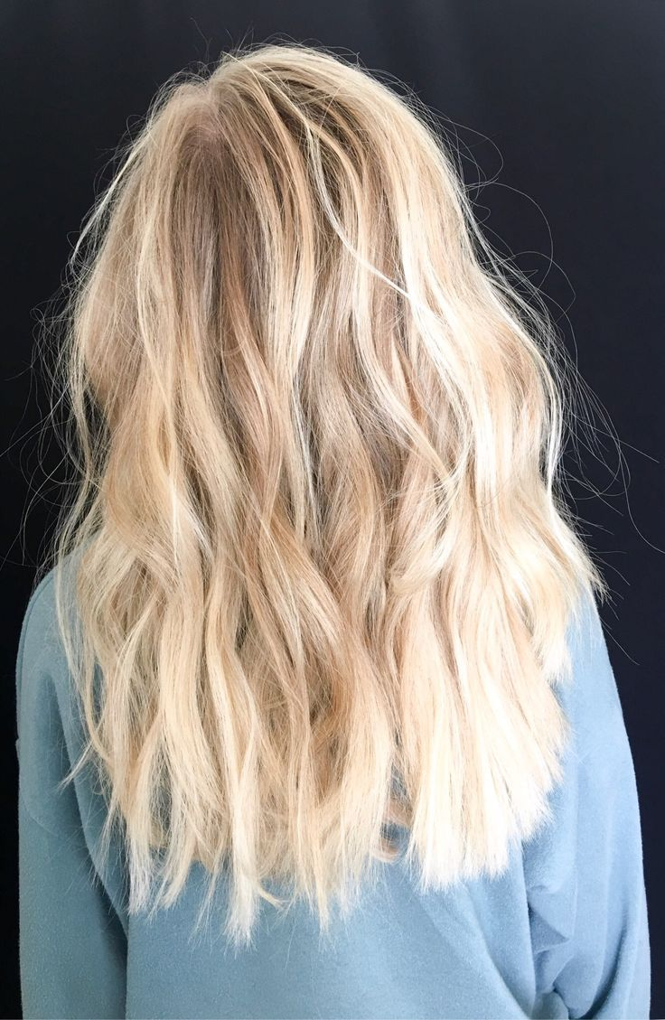 Photo of Bright blonde baby lights and balayage