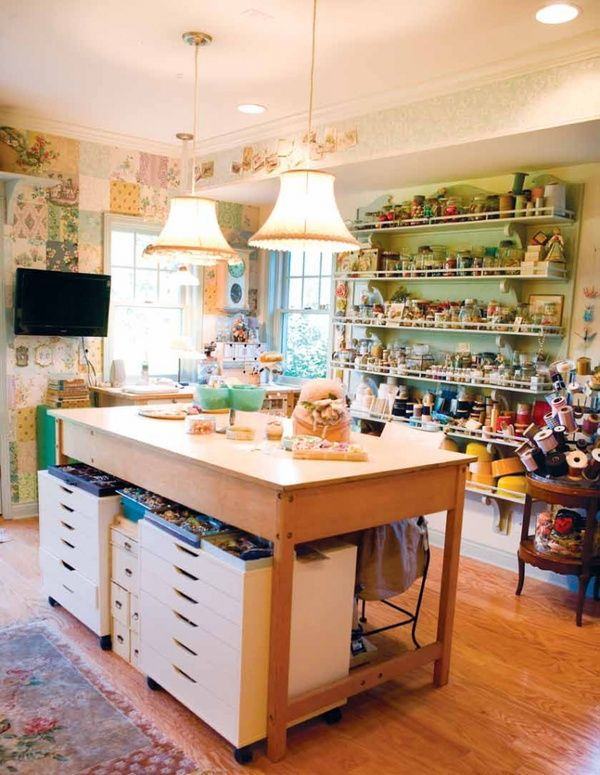 Craft room -- love the shallow shelves & work table, the decor not so much