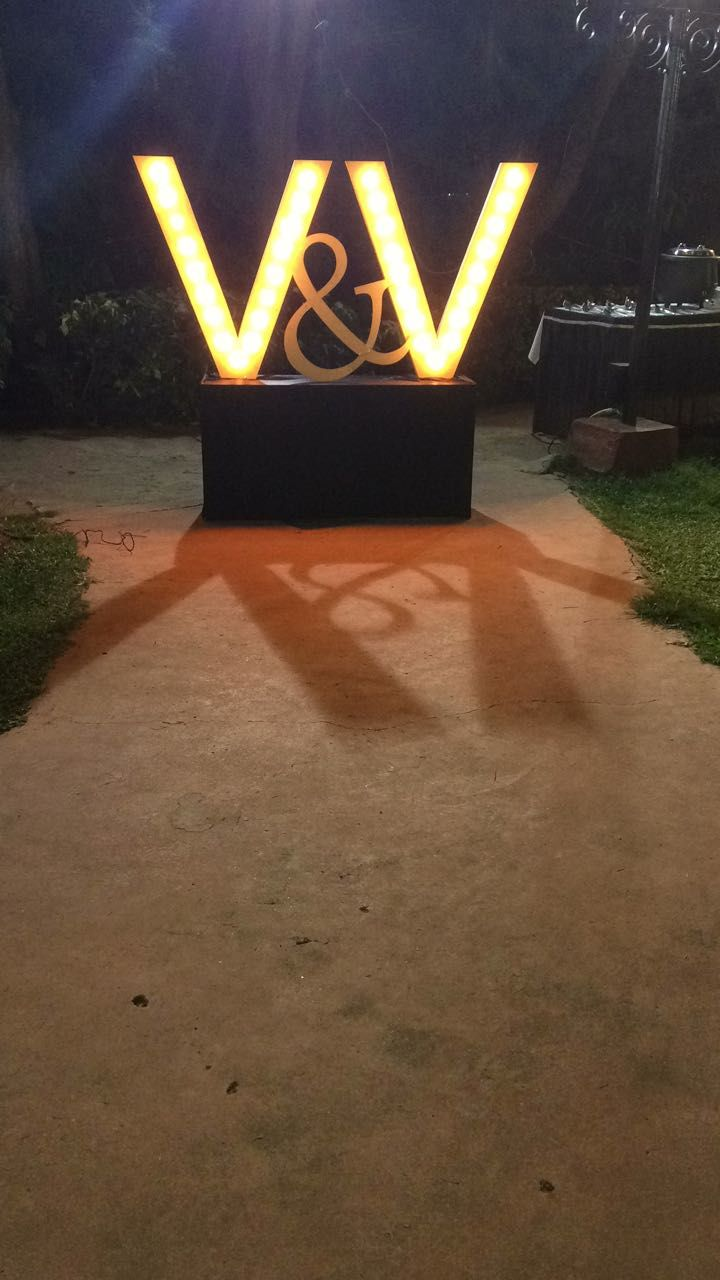Night wedding decor ideas  This element of couple initials illuminated with lights works well