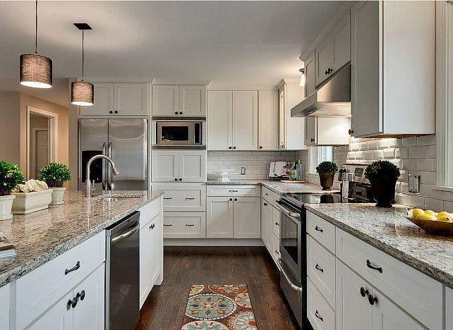 Kitchen with granite countertop. Kitchen granite. White Shaker ...