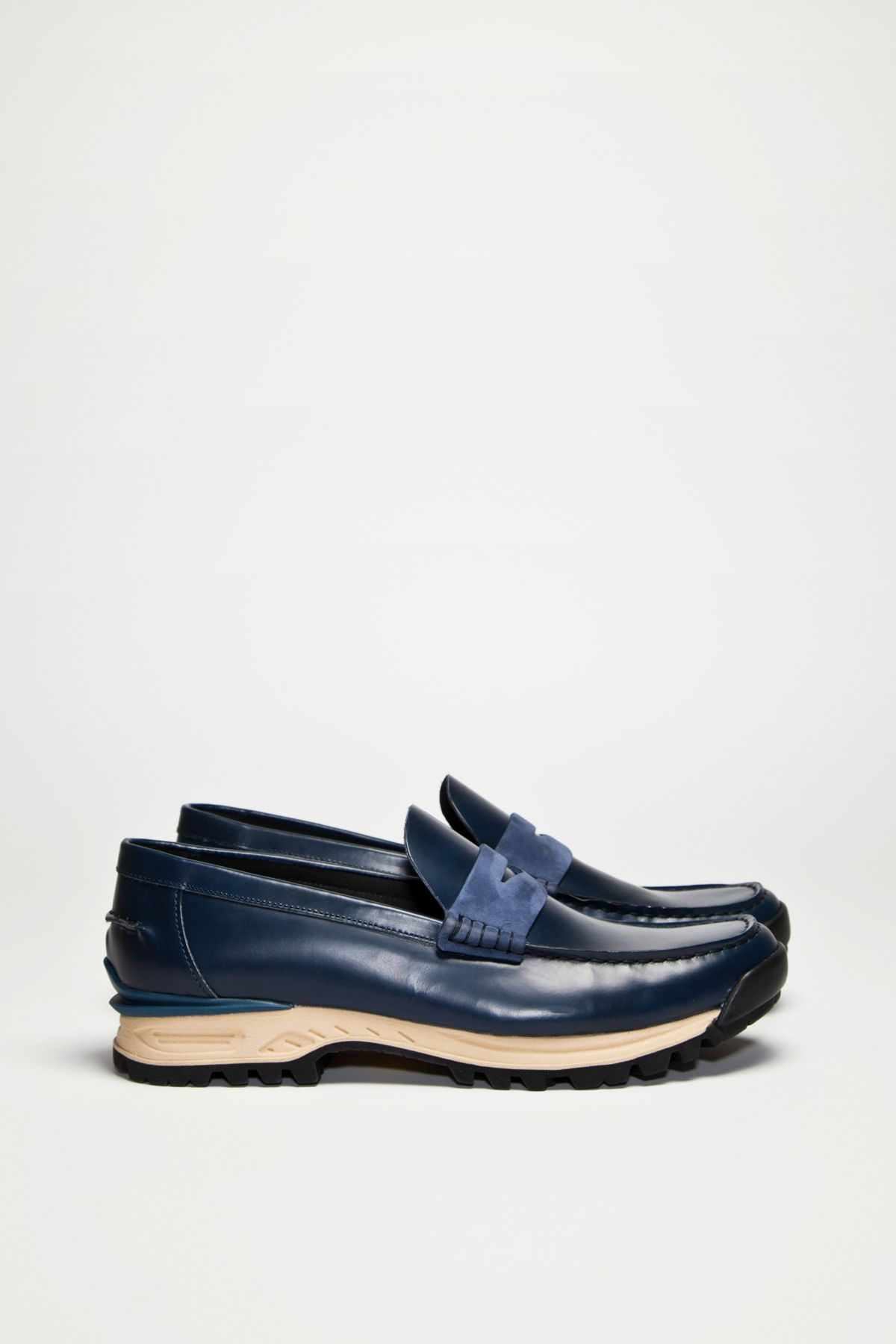 Innovative loafers from Acne. Penny loafer design in smooth leather, all  made in Italy. Chunky Vibram soles gives this classic shape an updated look. 396c94312e