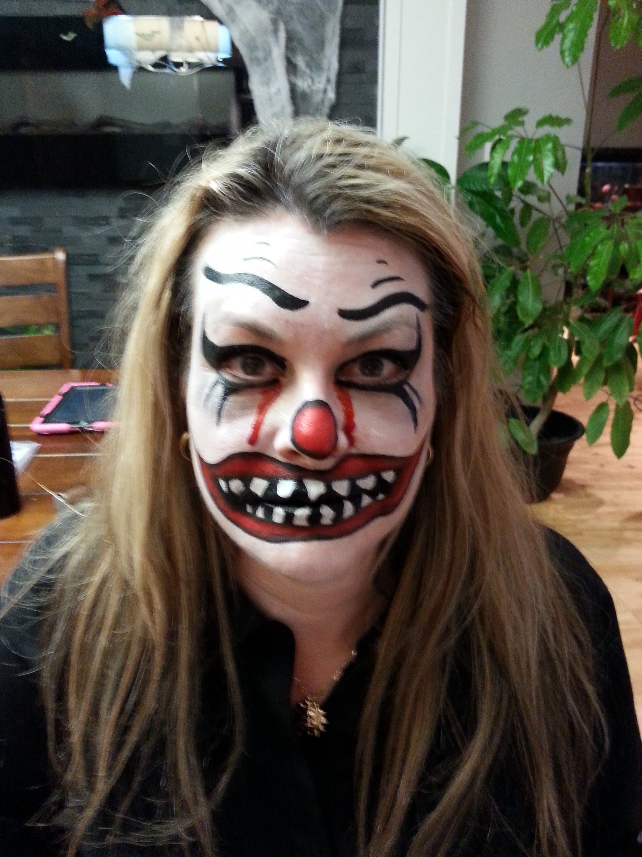 Scary clown makeup face painting.