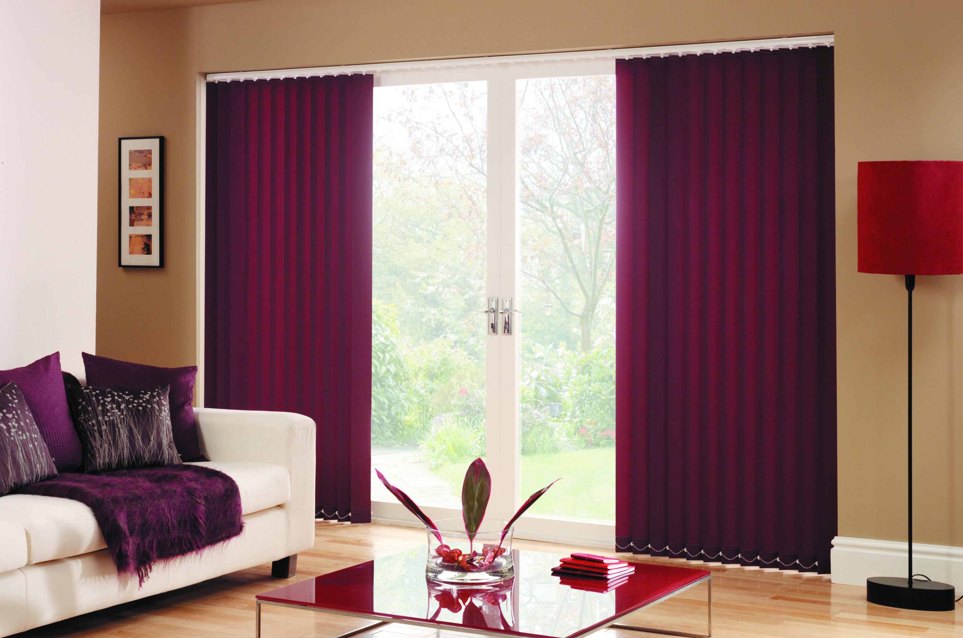 Our vertical blinds made up with carnival fabric in plum are a