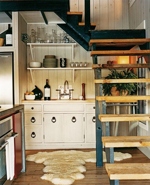 Little lake house kitchen by Thom Filicia--I like the tucked away feel of it and the pulls.