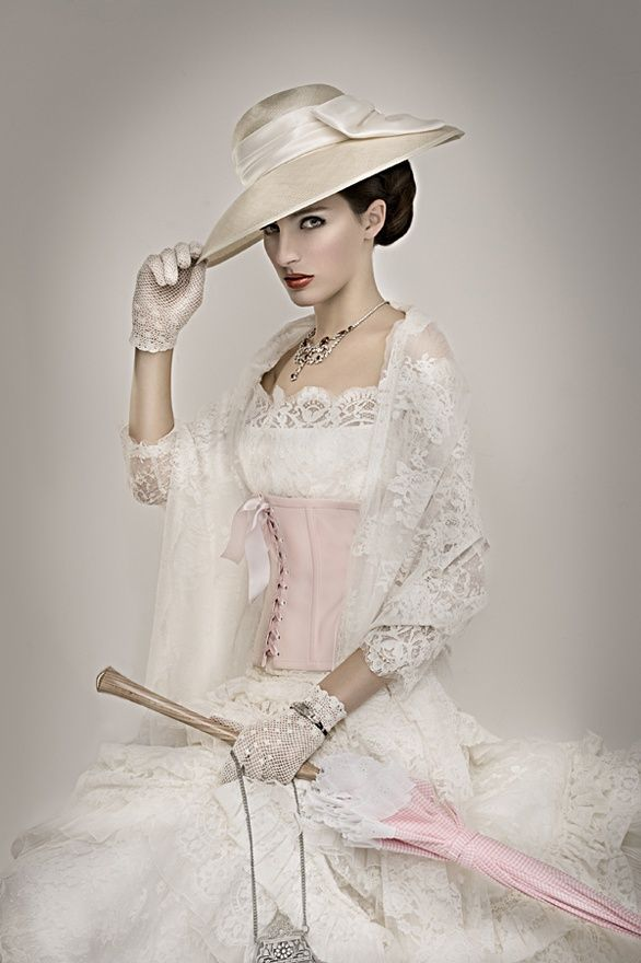 Vintage Edwardian-style white ensemble, complete with corset, hat, gloves and lace
