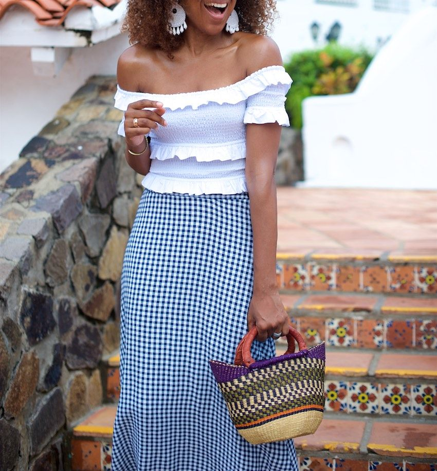 f39d8dbe5dbc4a Karen Blanchard is carrying a off the shoulder white top with a gingham  midi skirt and mini basket bag
