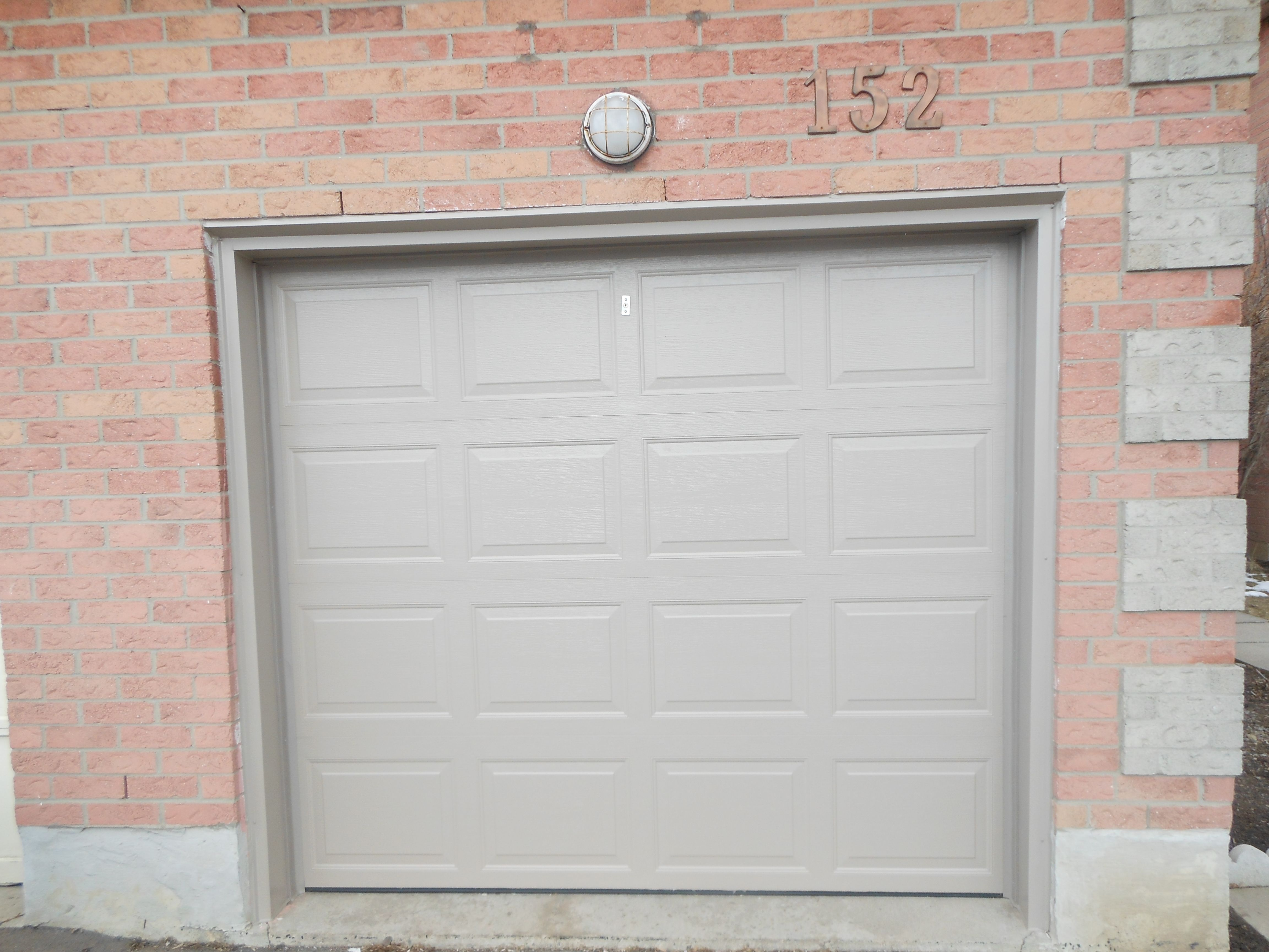 a completed single garage door replaced with a full capping ...