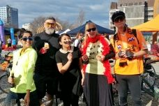 Lily Bui (center) poses at a GPS painting event in Christchurch, New Zealand.
