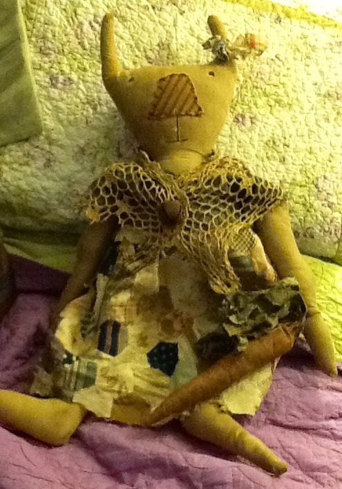 My bunny doll. Her dress is made from an old quilt top.