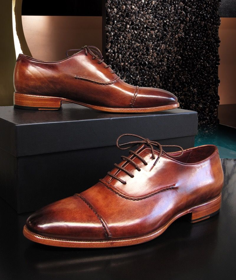 Paul Parkman Men's Captoe Oxfords Brown Hand Painted Shoes (ID077BRW) is part of Dress shoes men, Gents shoes, Dress shoes, Mens fashion shoes, Shoes mens, Brown oxford shoes - Oxford captoe style men's handmade shoes  Brown hand painted leather upper with leather sole and bordeaux leather lining   This is a madetoorder product  Please allow 15 days for the delivery  Because our shoes are handpainted and couturelevel creations, each shoe will have a unique hue and polish, and color may differ slightly from the picture