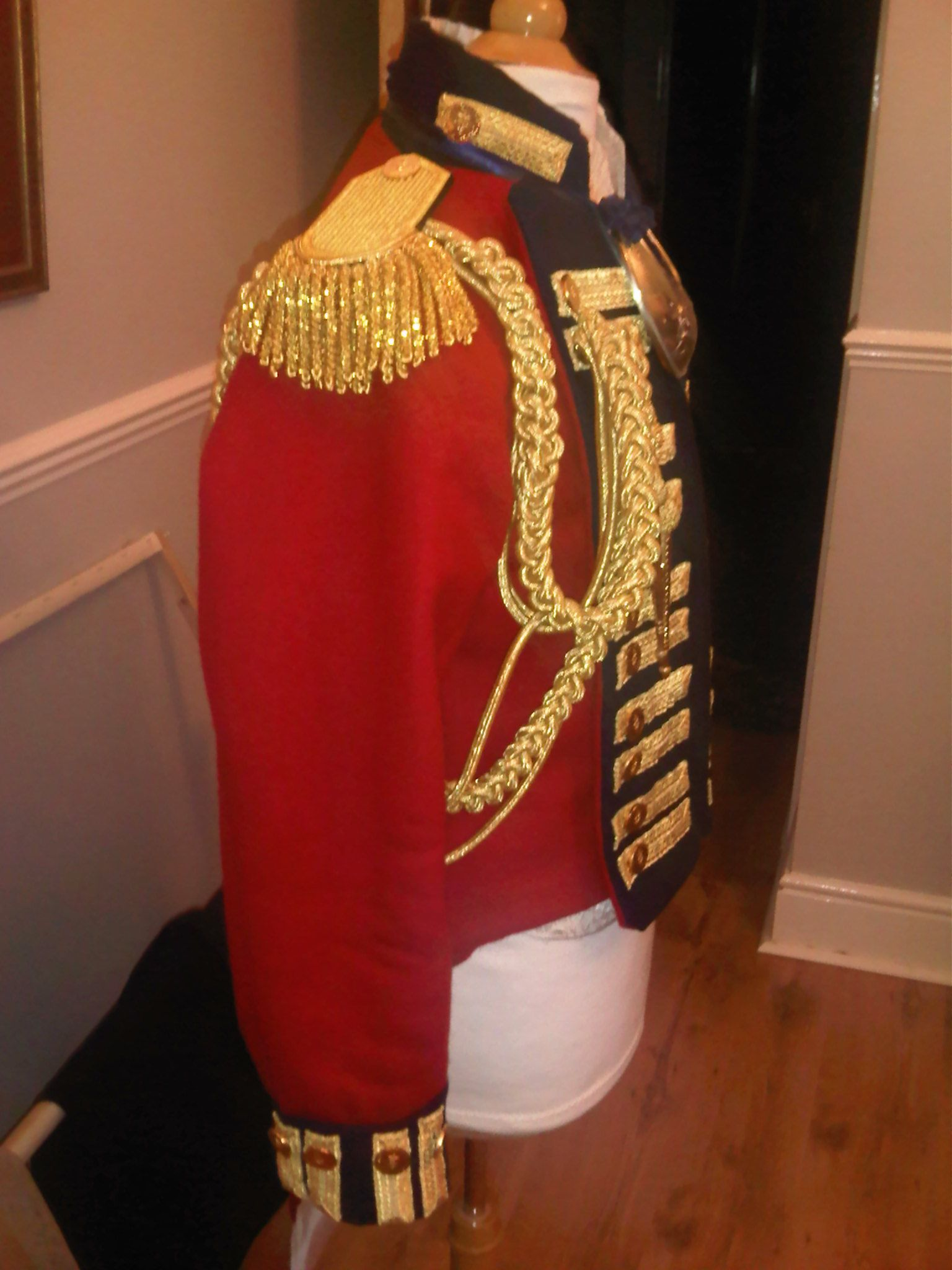 British officer's uniform, from the Napoleonic wars. Presumably the sort of get-up John would have worn as a staff officer. I can totally see how those epaulettes would deflect a spent musket ball.