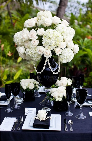 Black vases white flowers a very pretty floral setting for a black vases white flowers a very pretty floral setting for a wedding or could mightylinksfo Image collections