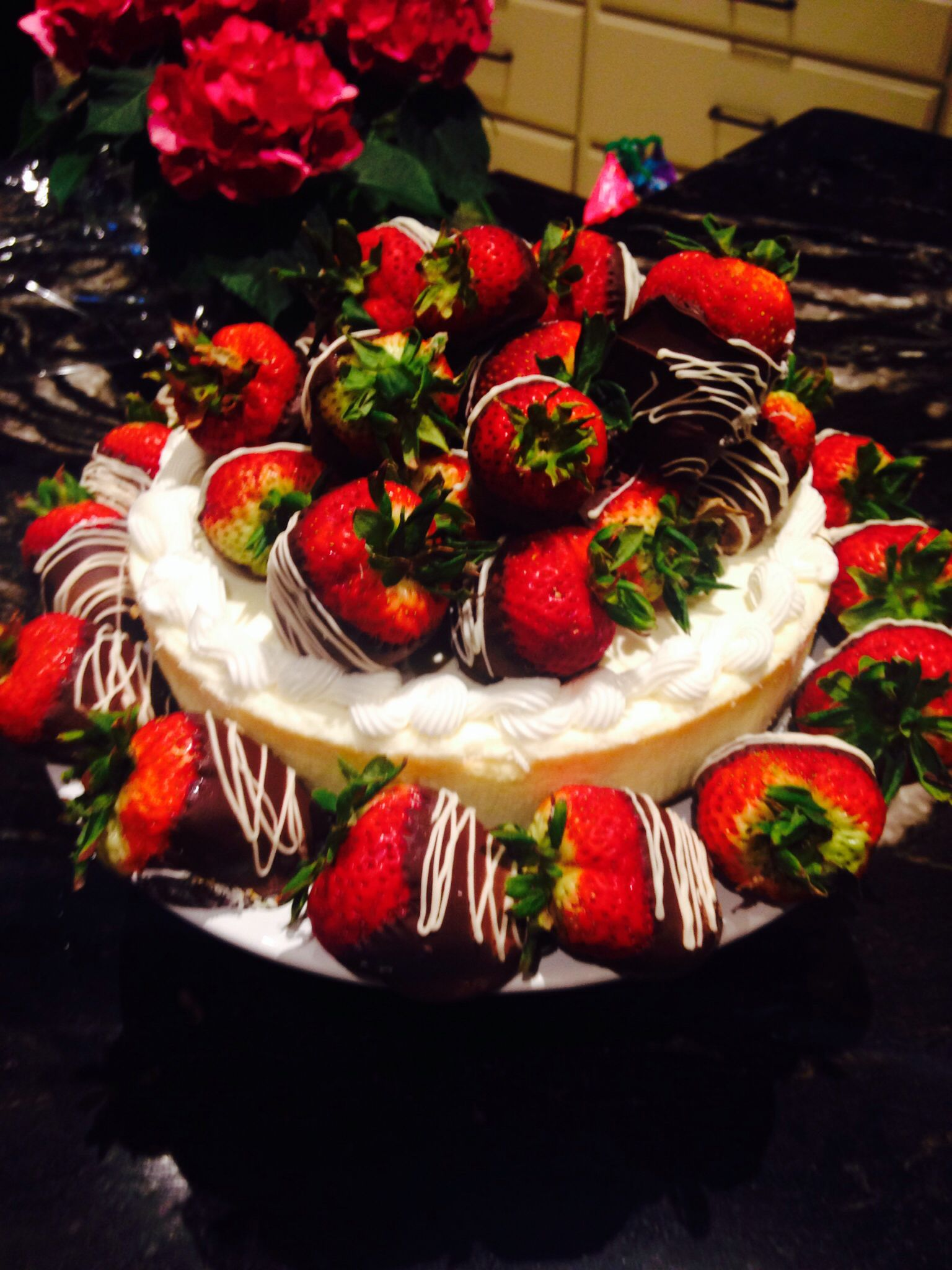 Great Mother's Day dessert get a plain cheesecake and make some chocolate covered strawberries