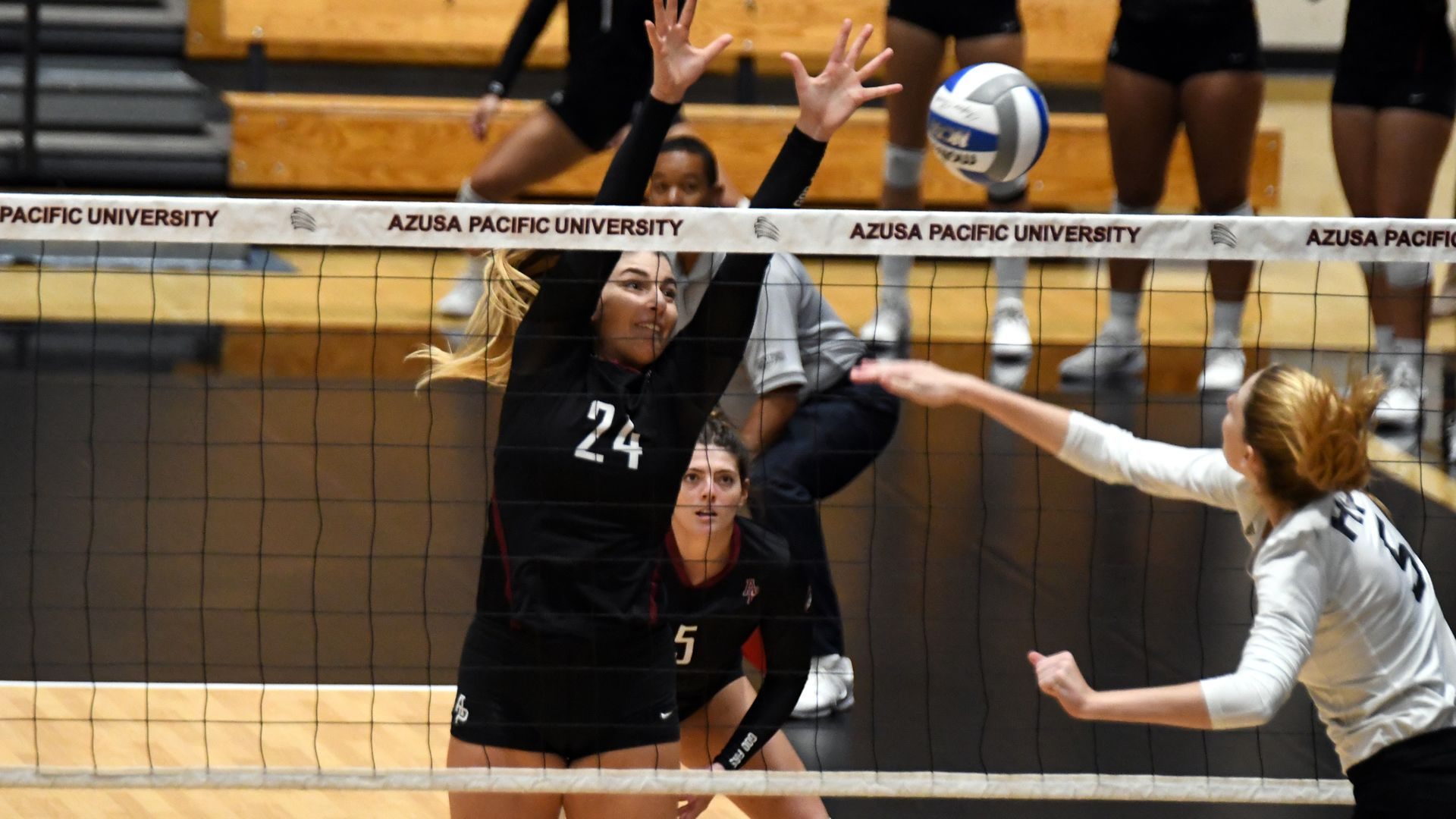 Azusa Pacific Volleyball Outside Hitter Katarina Radisic Jumps At The Net For A Block During The Cougars Four Set Azusa Pacific Azusa Pacific University Azusa