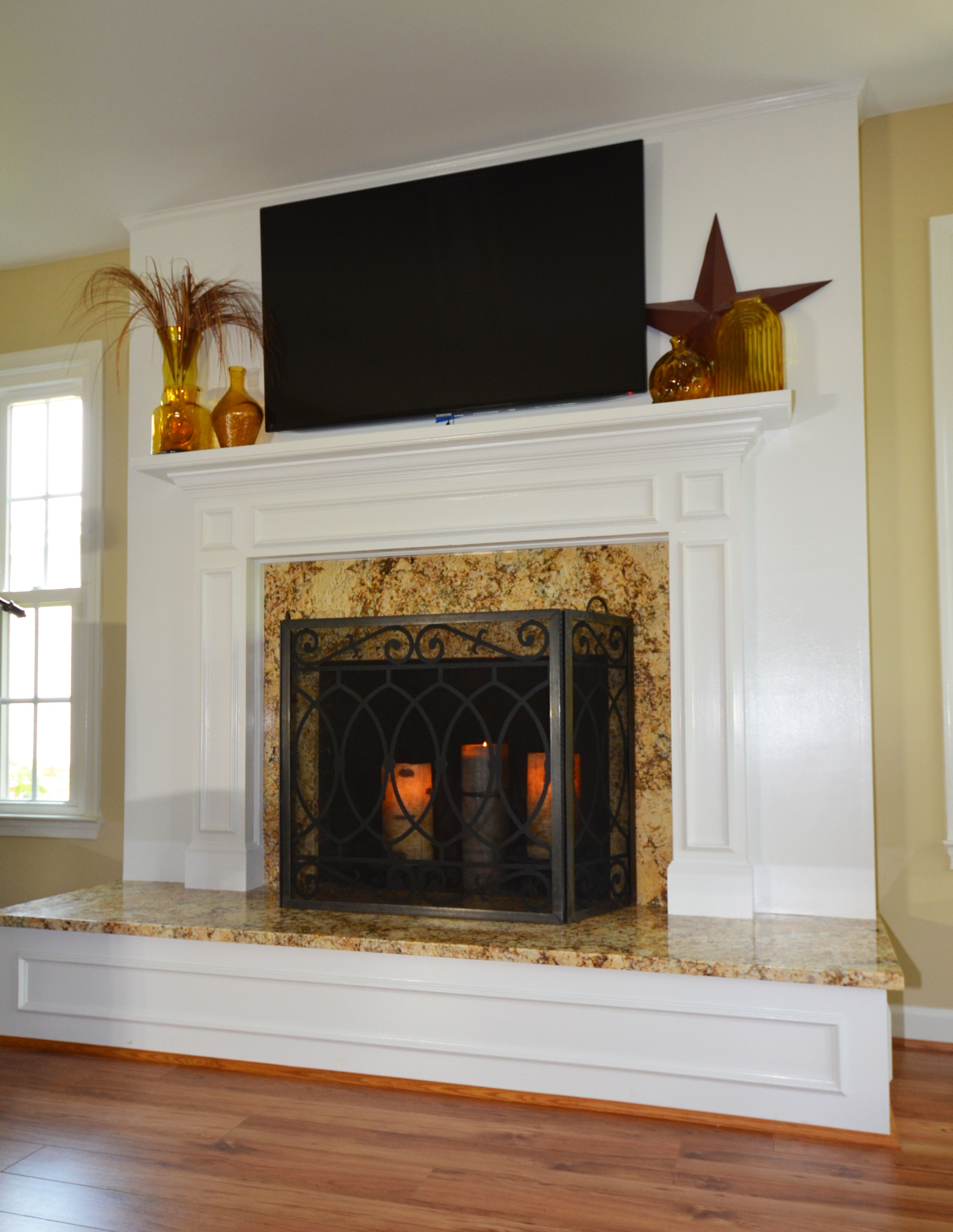 This previously brick fireplace in fairfax va was - How to reface a brick fireplace ...
