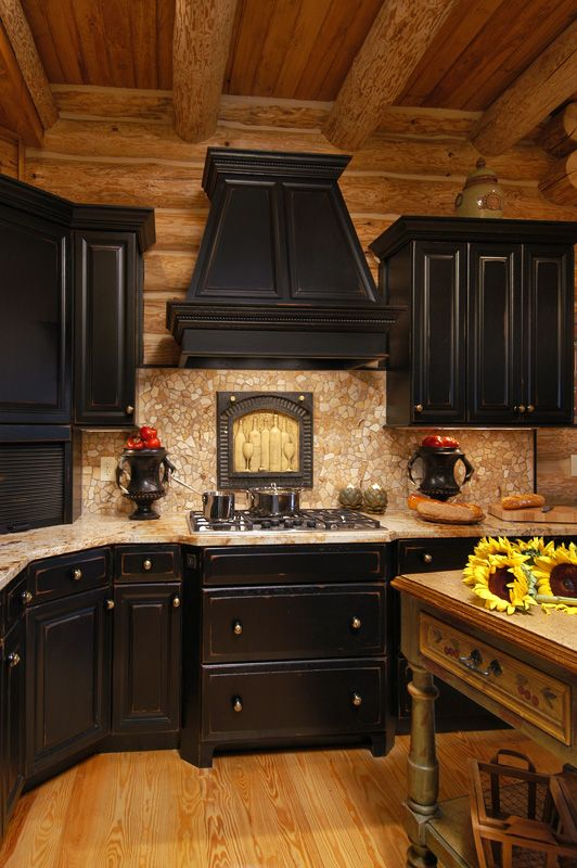 Log home in valle crucis featuring black cabinets with rub for Log cabin kitchen backsplash ideas