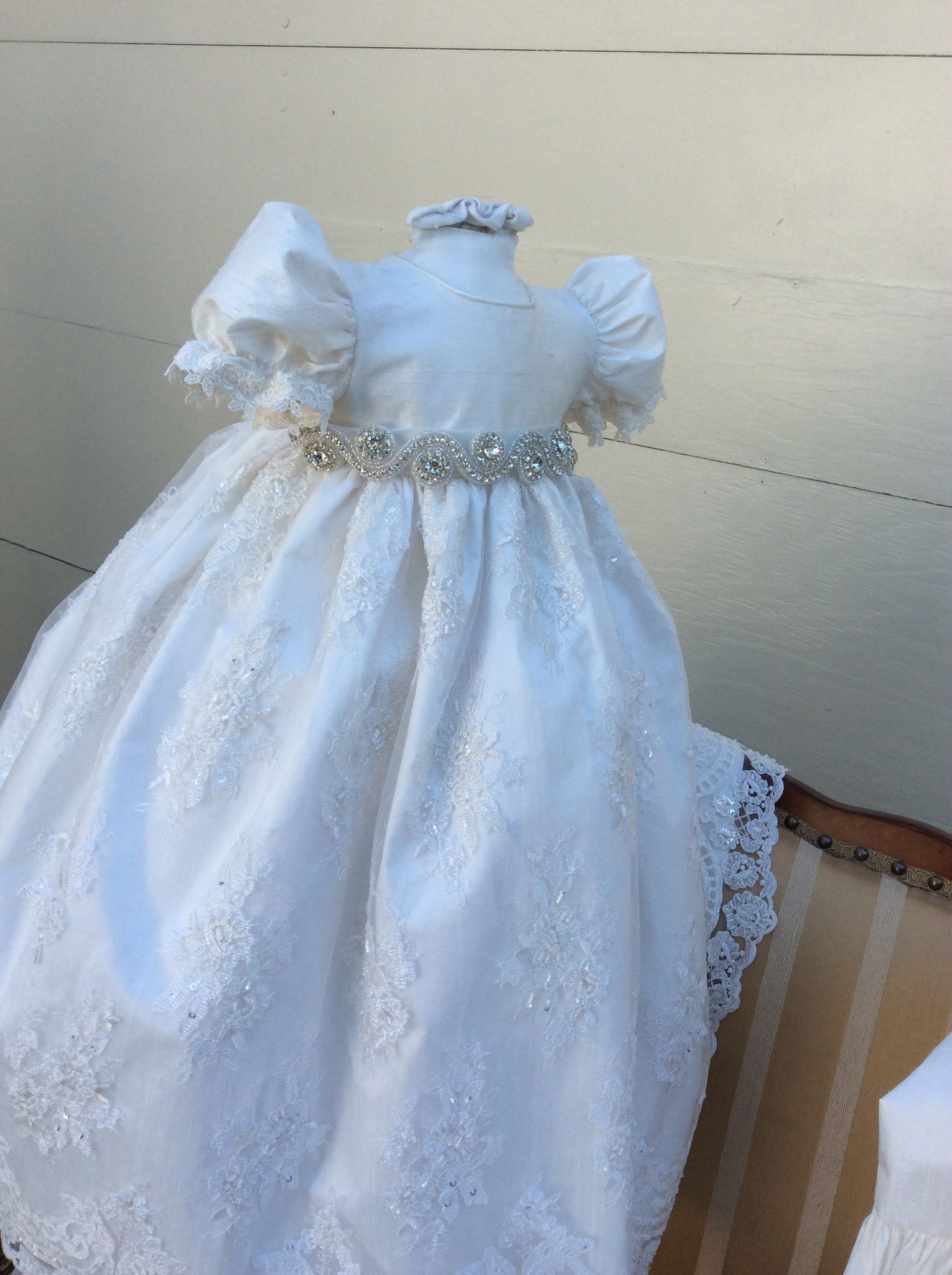 Dupioni silk dress with crystal sash and double ruffle sleeve ...