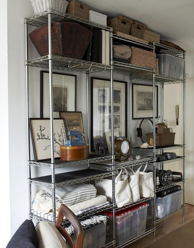 commercial kitchen shelving units in the living room of a small home ...