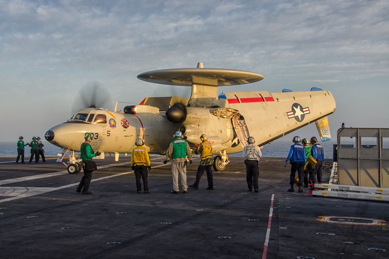 """A Northrop Grumman E-2C Hawkeye, from Carrier Airborne Early Warning Squadron 112 (VAW-112) """"Golden Hawks,"""" is parked on the stern of the USS John C. Stennis (CVN 74) after a training mission."""