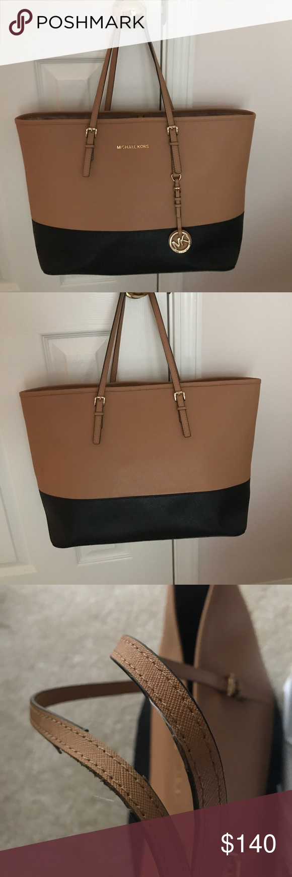 7806e28a0006 Large Michael Kors Getaway Tote Top half caramel/tan color Bottom half  black, Gold Hardware, Small damage on handles, Pen mark stain inside, Good  condition ...
