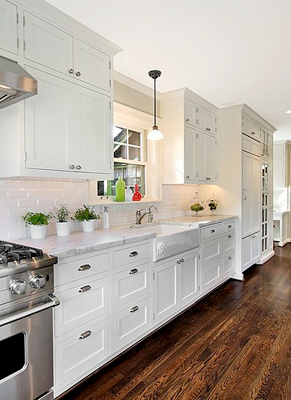 Lots of drawers - great use of space in this white galley kitchen ...
