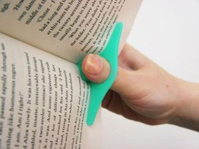 omg! it holds your book open while you read it! i want this.   My ...