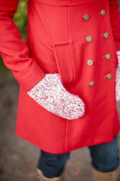 Cozy for winter in mittens and a red coat