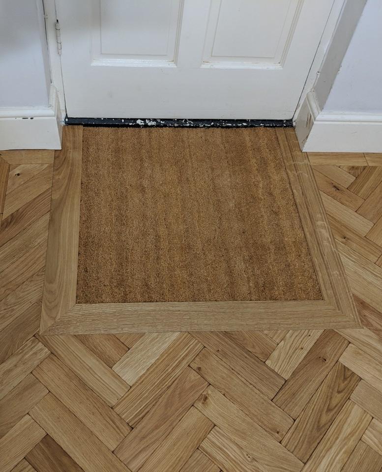Integrated Door Mat Framed Within A Parquet Engineered Oak
