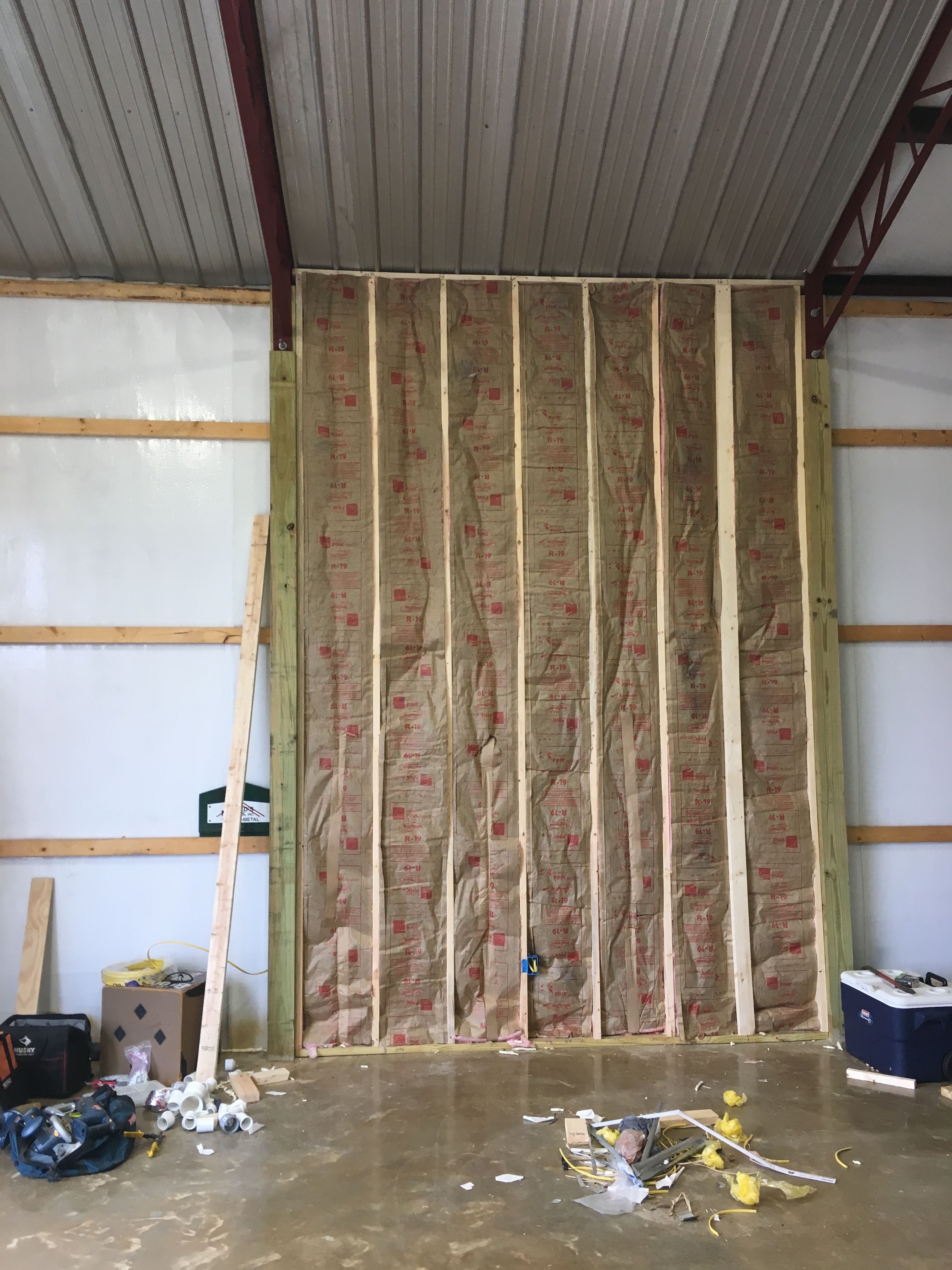 Garage Wall Going Up Fourteen Foot Side Walls Using R19 Insulation And It Already Has A Bubble Wrap On It Garage Walls Pole Barn Homes Building Insulation