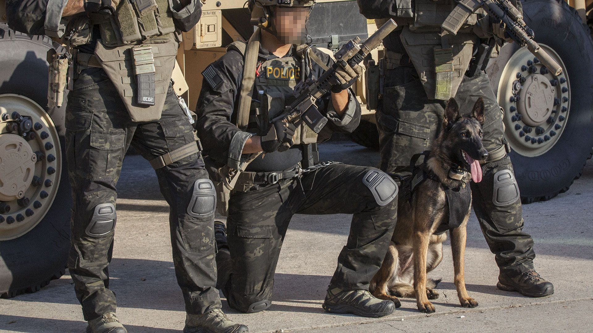 6da35e8388e police in multicam black