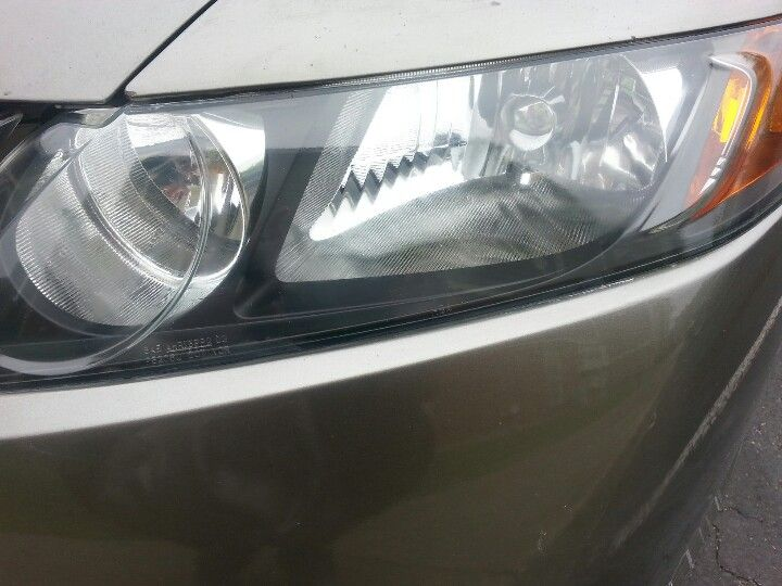 Clean yellow headlights with off insect repellent spray