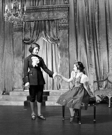 Princess Elizabeth is Prince Charming and Princess Margaret is Cinderella in a royal pantomime at Windsor Castle, December 1941. <p>By Lisa Sheridan/Studio Lisa/Getty Images.</p>