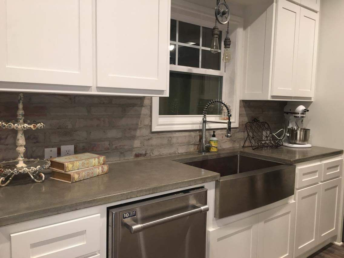 Concrete countertops white cabinets stainless steel sink modern ...